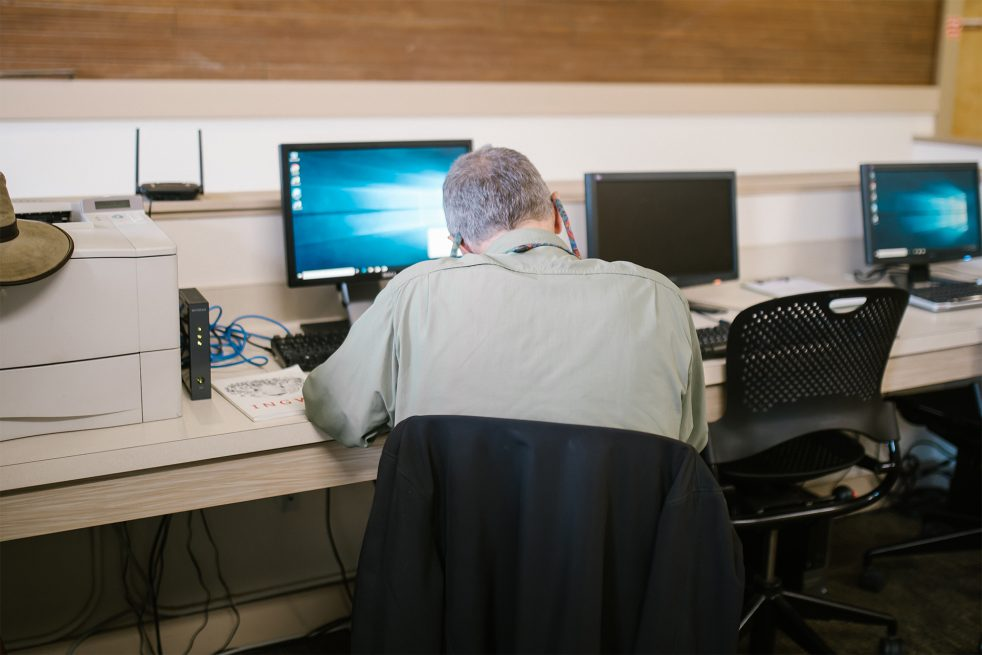 older man at a computer