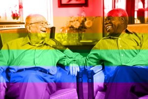 two older senior men with rainbow coloring