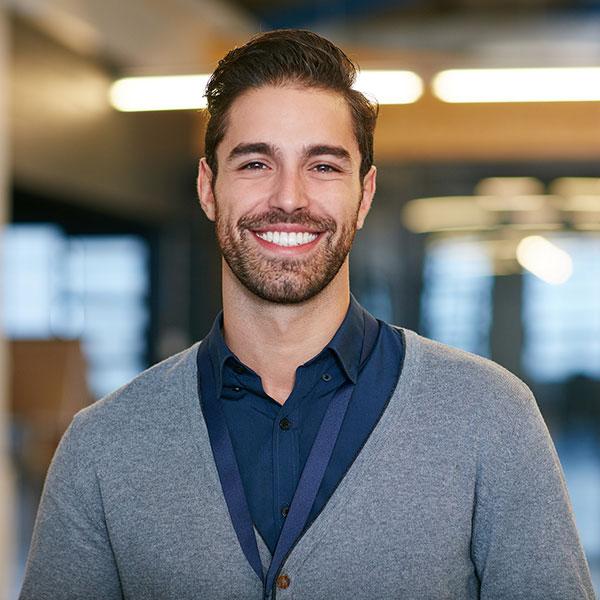 Corporate man at work, smiling