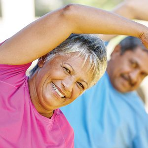 Senior woman and man exercising outdoors