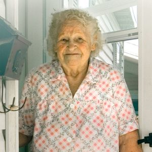 Senior woman outside her front door