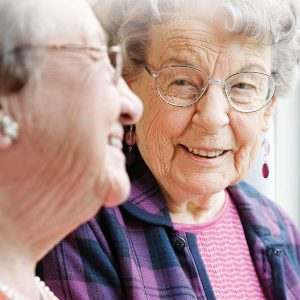 Two senior women talking and smiling