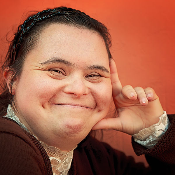 Smiling adult woman with a disability