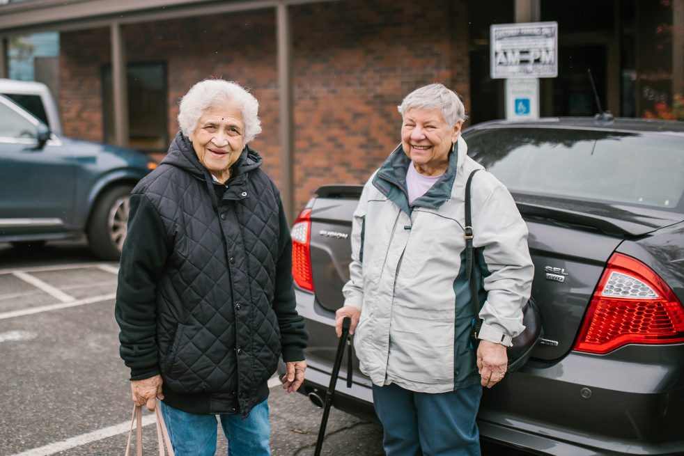 Volunteer transportation driver and client outside the appointment place