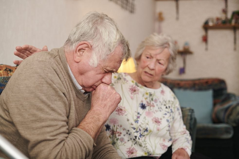 older man who is ill with his wife