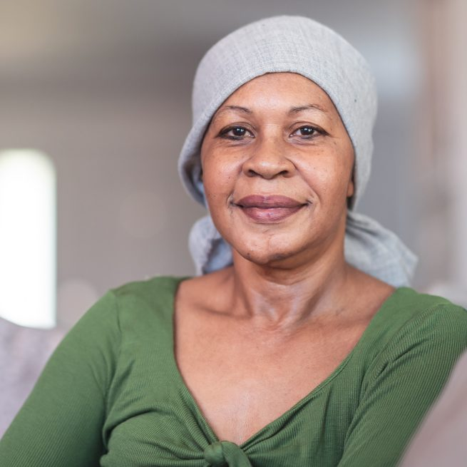 older woman with scarf on her head