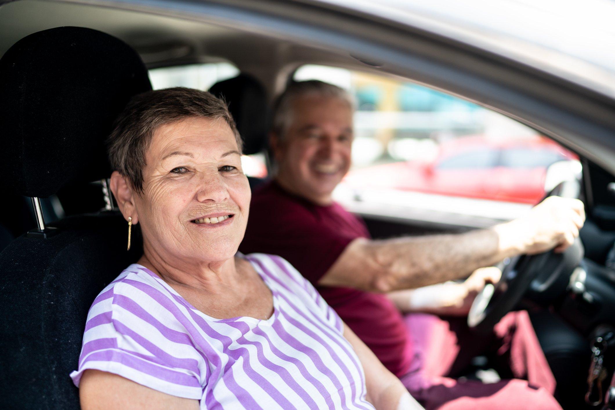 Older adult in passenger seat