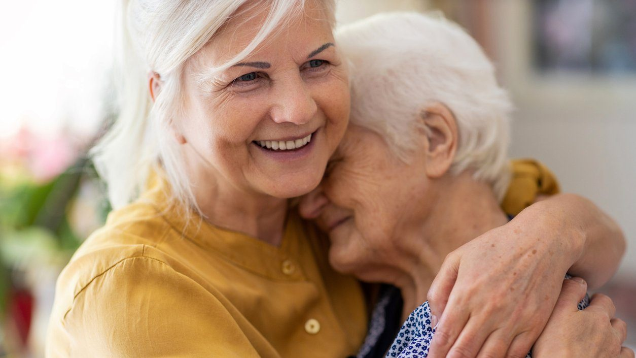 Woman spending time with her elderly mother