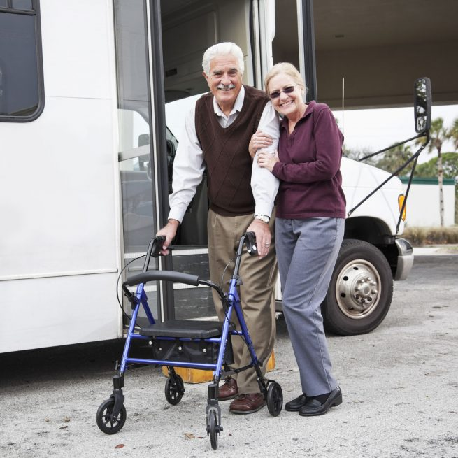 older couple standing outside transportation shuttle