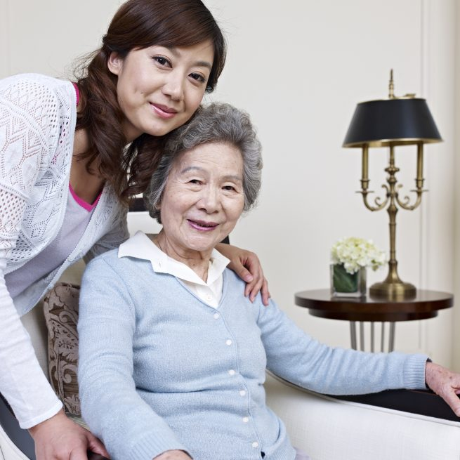 elderly woman with younger daughter/caretaker